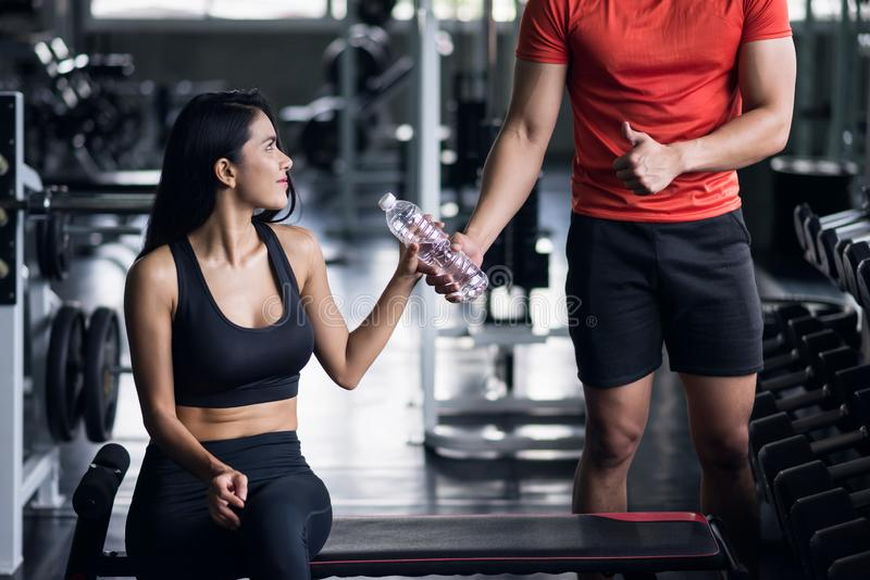 trainer thumb up and give bottle water stock image