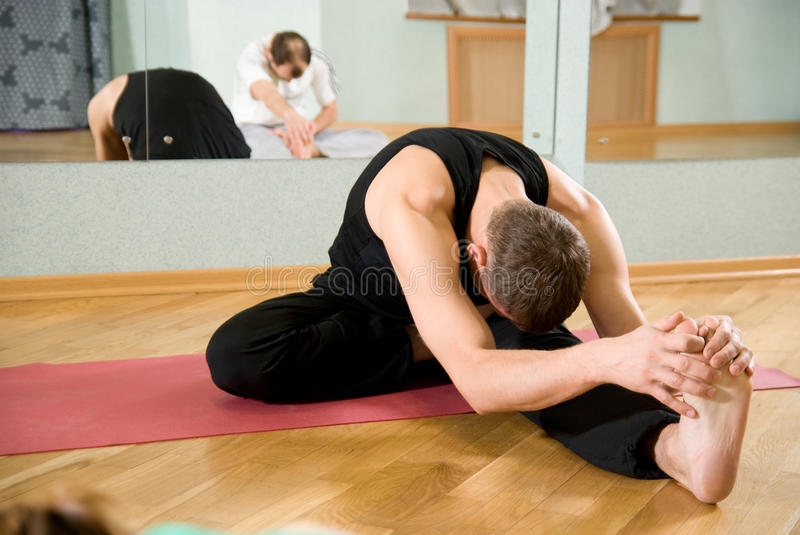 The trainer on yoga stock photo