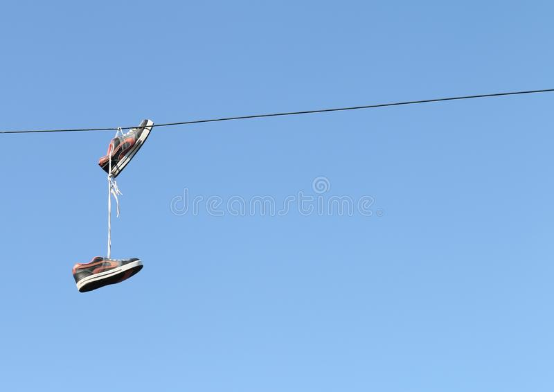 Trainers On Telephone Line stock photo