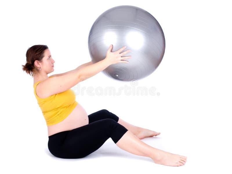 Trainieren der schwangeren Frau stockfoto
