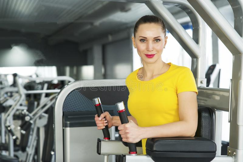 Young pretty muscular woman doing Fitness exercise. stock image