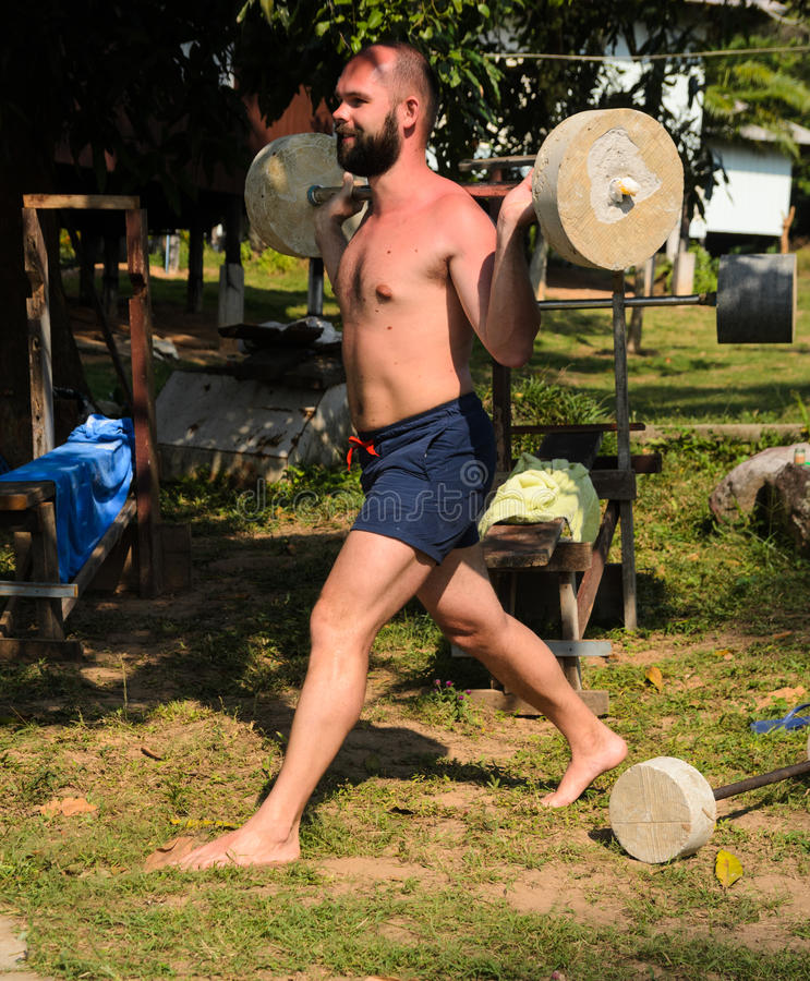 Training with barbell outdoors stock image