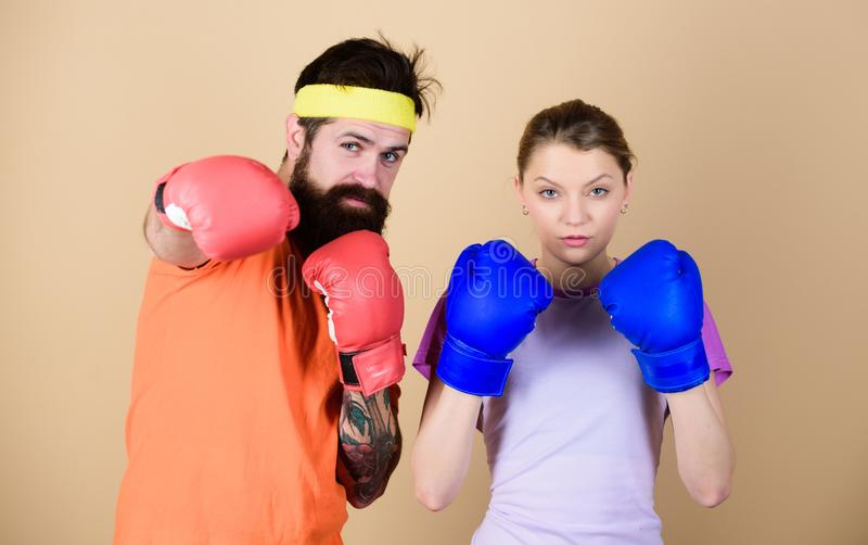 Training with coach. sportswear. Fight. knockout and energy. couple training in boxing gloves. punching, sport Success. Happy women and bearded men workout in royalty free stock photo