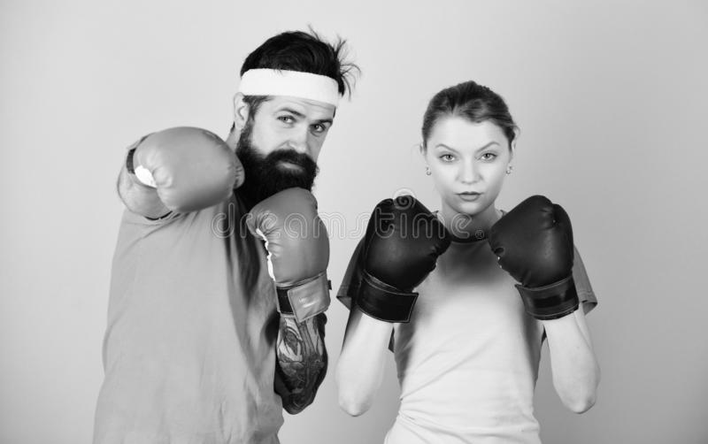 Training with coach. sportswear. Fight. knockout and energy. couple training in boxing gloves. punching, sport Success. Happy women and bearded men workout in stock photos