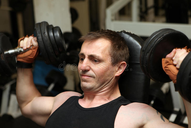 Training dumbbells gym pecks stock images