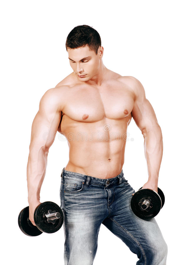 Training with dumbbells. Portrait of a handsome muscular bodybuilder posing with dumbbell. Isolated over white background stock image