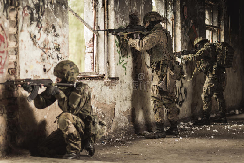 Training exercise with weapon. Military soldiers during training exercise with weapon stock photography