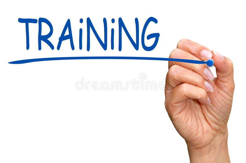Training - female hand with marker writing blue text stock image