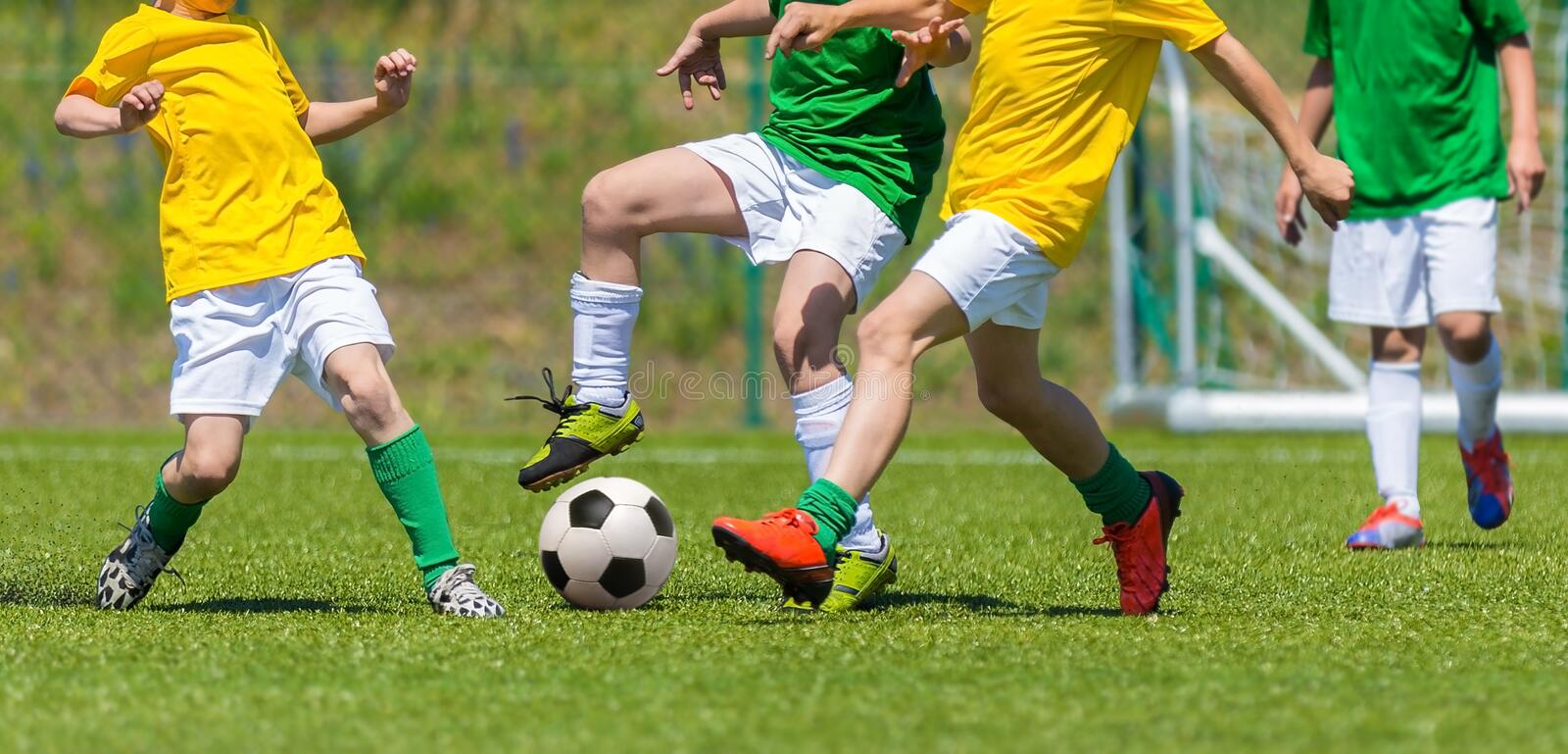 Training and football match between youth teams. Young boys play. Training and football match between youth soccer teams. Young boys playing soccer game. Hard stock image