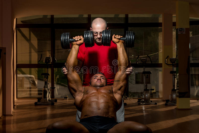 Download Training In Gym Where Partner Gives Encouragement Stock Photos - Image: 31565653
