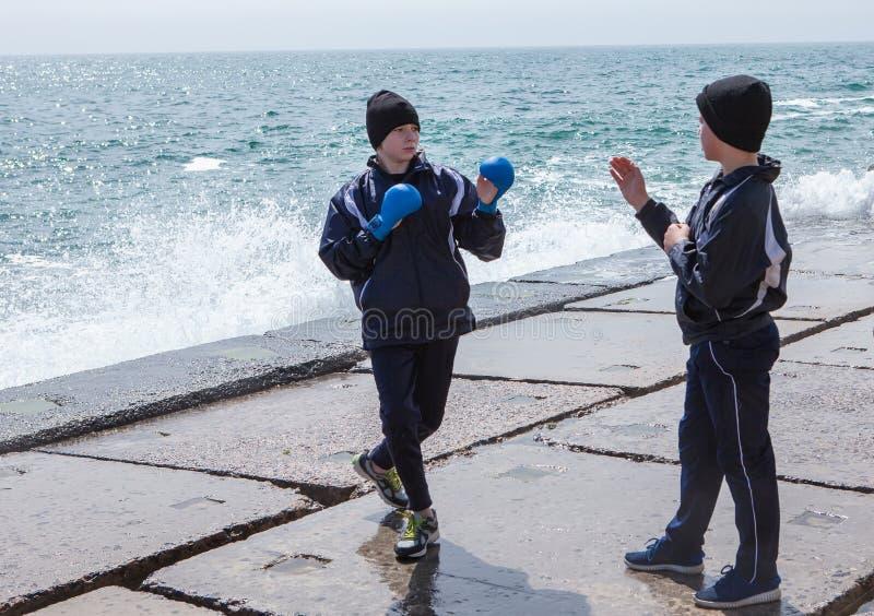 Training karate on the stone coast stock images