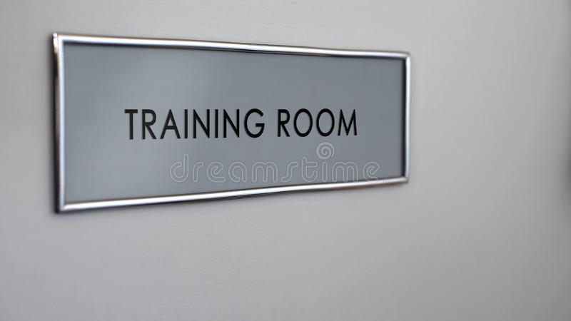 Training room door plate closeup, visit at business conference, company seminar. Stock photo stock photos