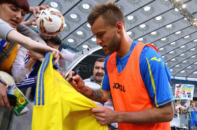 Training session of Ukraine National Football Team in Kyiv. KYIV, UKRAINE - JUNE 2, 2017: Player Andriy Yarmolenko gives autograph during Open training session stock photo