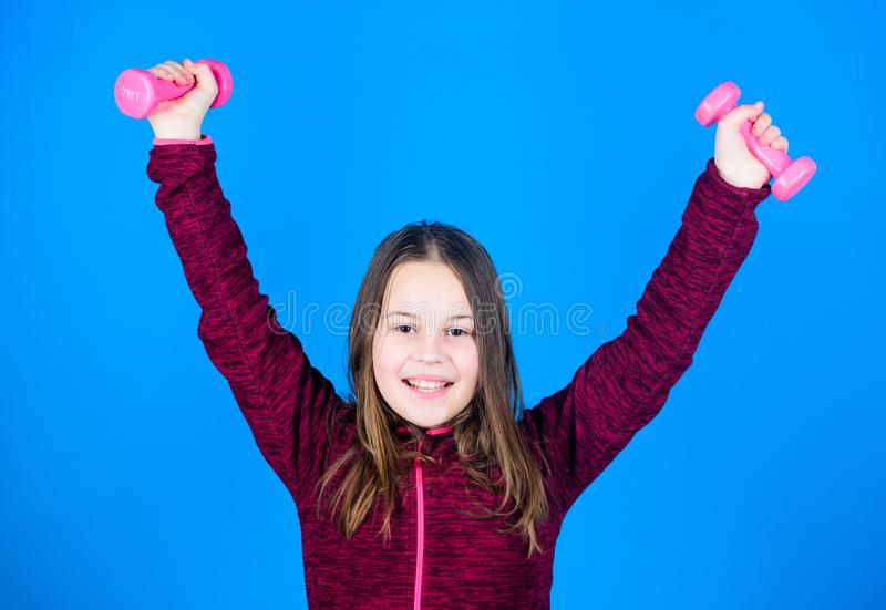 Training of small girl hold dumbbell. Happy child training with barbell. happy training. Fitness diet for energy. weight. Lifting for muscules. Childhood stock photos