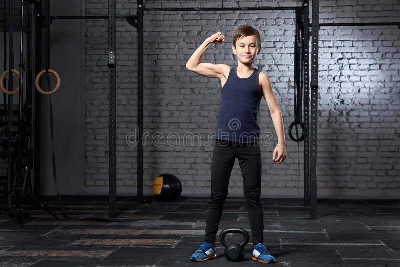 Training and sport. Kid in crossfit gym. Healthy lifestyle. royalty free stock images