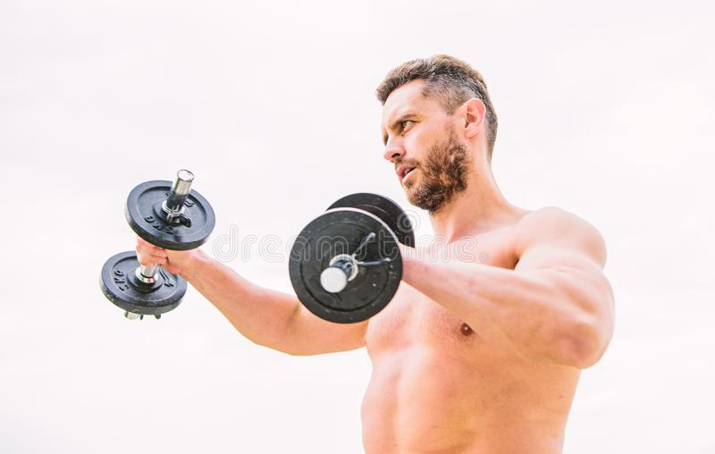 Training to be the best. success. Perfect biceps. fitness and sport equipment. man sportsman with strong hands. steroids royalty free stock photography