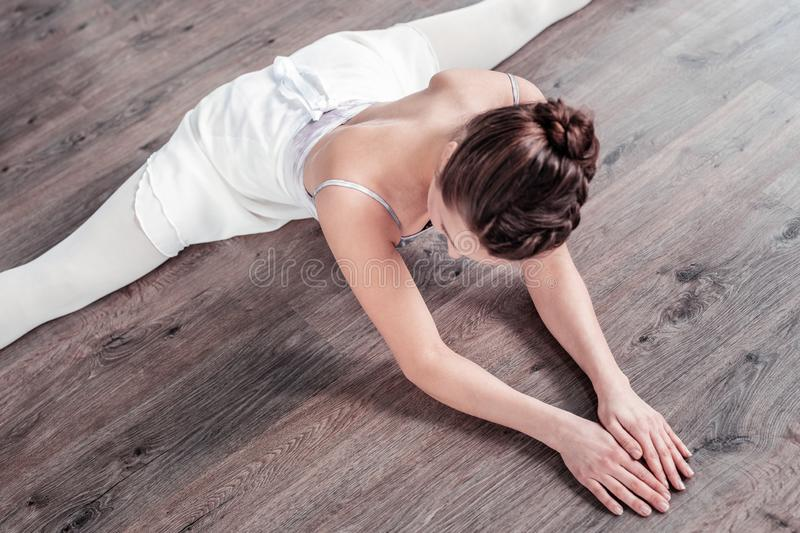 Top view of a nice young woman doing the splits royalty free stock photography