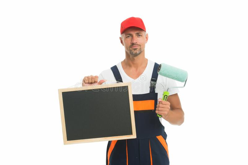 Training that transforms beginner into skilled professional. Painter hold blackboard and paint roller. Decorator. Training course. Training school. Training in stock photo