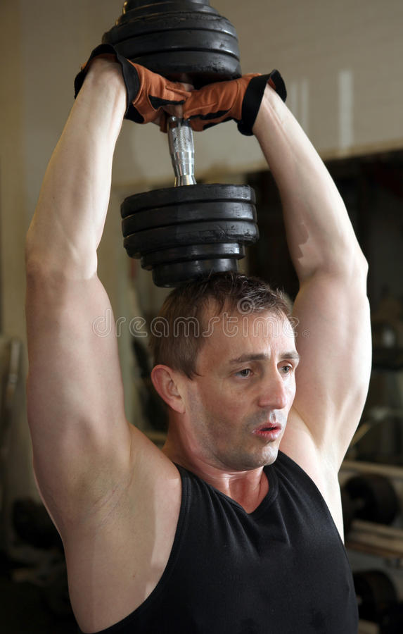 Training triceps weights dumbbell royalty free stock photos