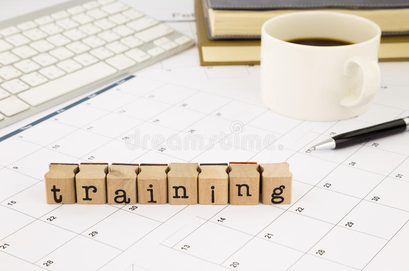 Training wording and timetable on office table. Closeup training wording stack on office table, schedule and calendar for planing training course, business and stock image