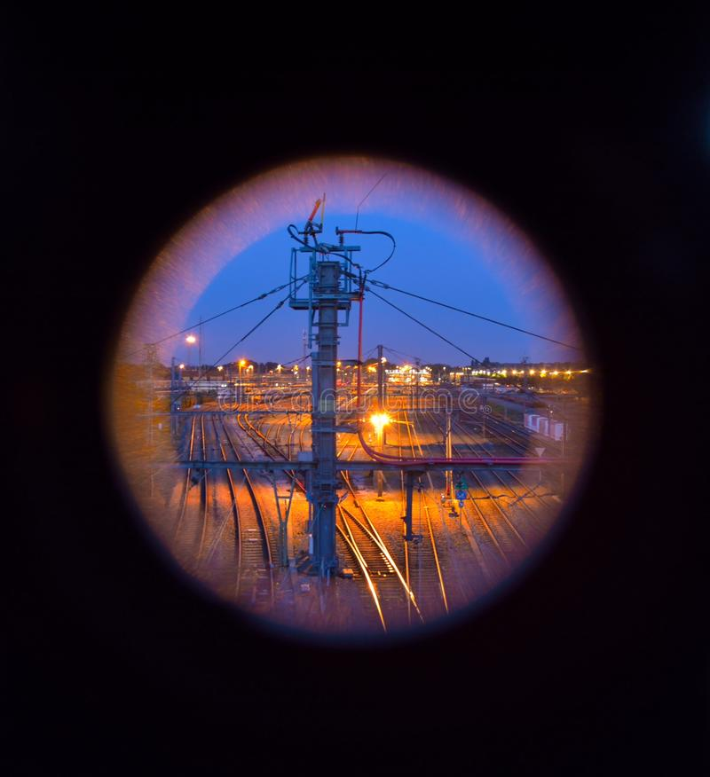 Trainrails through a peephole. At night royalty free stock photo