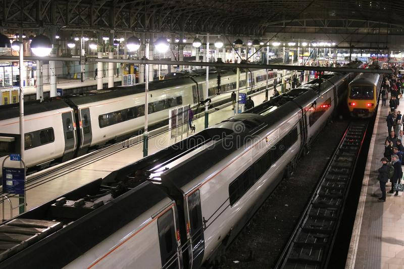 Trains at platforms Manchester Piccadilly at night royalty free stock photos
