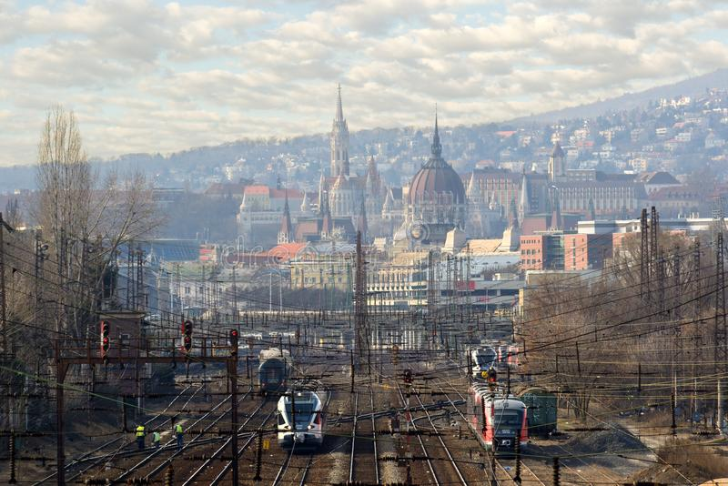 Trains on railroad tracks against Budapest city view stock photo