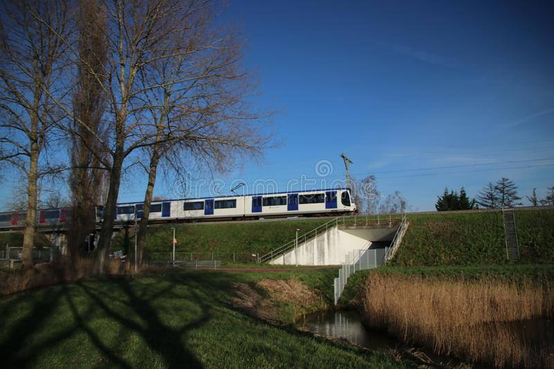 Trains of RSG3 RET Metro Randstadrail on track at Leidschenveen in the Netherlands. Trains of RSG3 RET Metro Randstadrail on track at Leidschenveen in the royalty free stock images