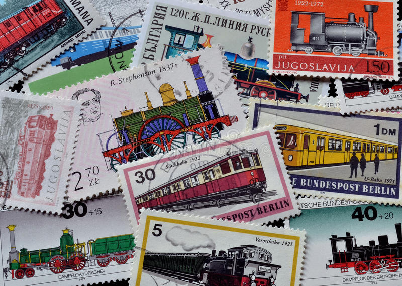 Trains on stamps stock photos