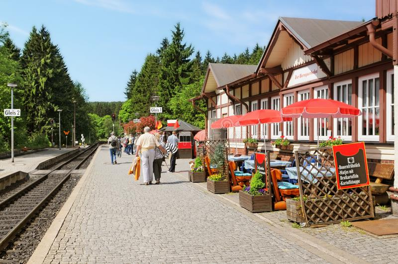 Trainstation in village Schierke of historical locomotive up to Brocken Peak. People waiting for the train to arrve royalty free stock photo