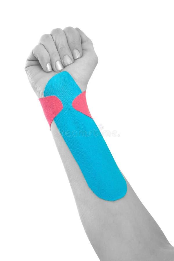 Traitement thérapeutique de poignet avec la bande de tex. photos stock