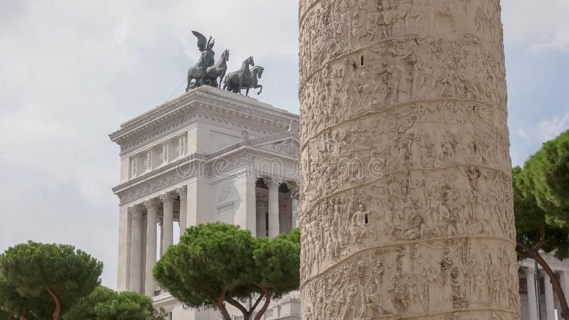 Trajans column and the monumento nazionale a vittorio emanuele II in rome royalty free stock photo