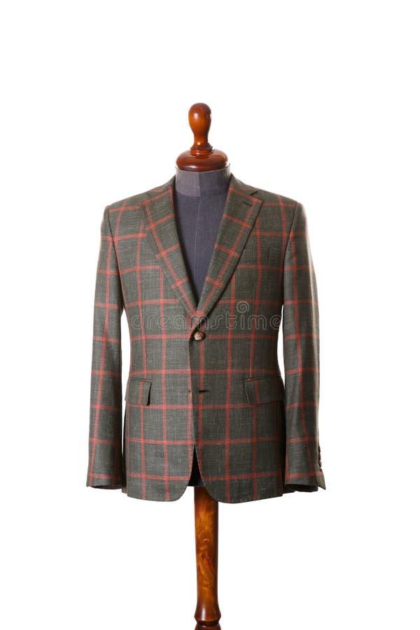 Traje o chaqueta masculino en mannequim en el blanco fotografía de archivo libre de regalías