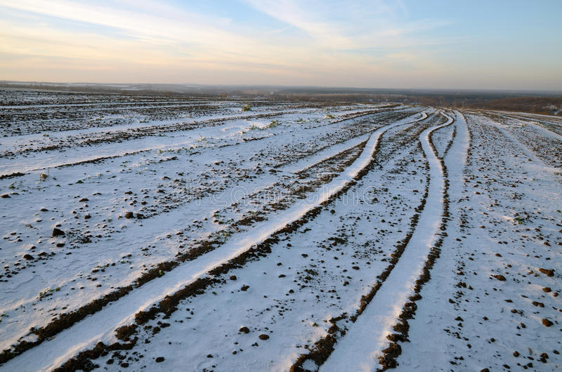 The trajectory of the way an a plowed field and covered with snow stock image