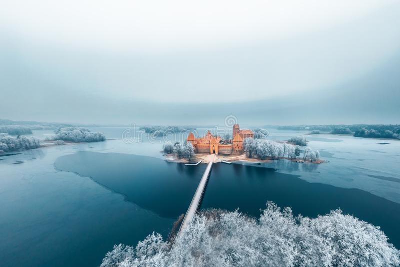 Trakai Island Castle and frosty trees, Lithuania. Trakai Island Castle, winter season, frosty trees and frozen water, aerial view. History Museum royalty free stock image