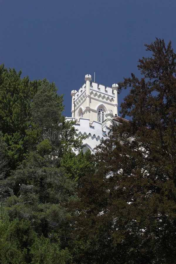 Trakostan castle Croatia. White tower of Trakoscan castle with trees in foreground, Croatia stock image