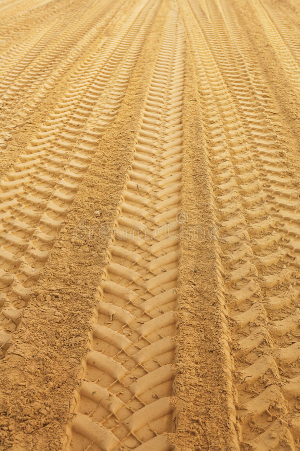 Traks on sandclose up stock photos