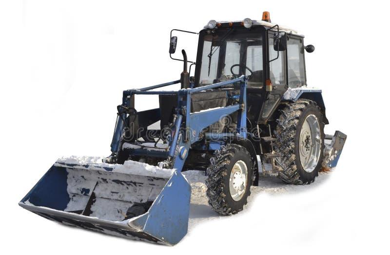 Traktor för snöborttagning bakgrund isolerad white Ryssland royaltyfri bild