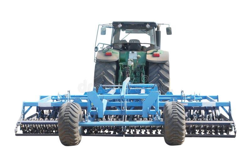 Traktor mit einem Pflug stockbild
