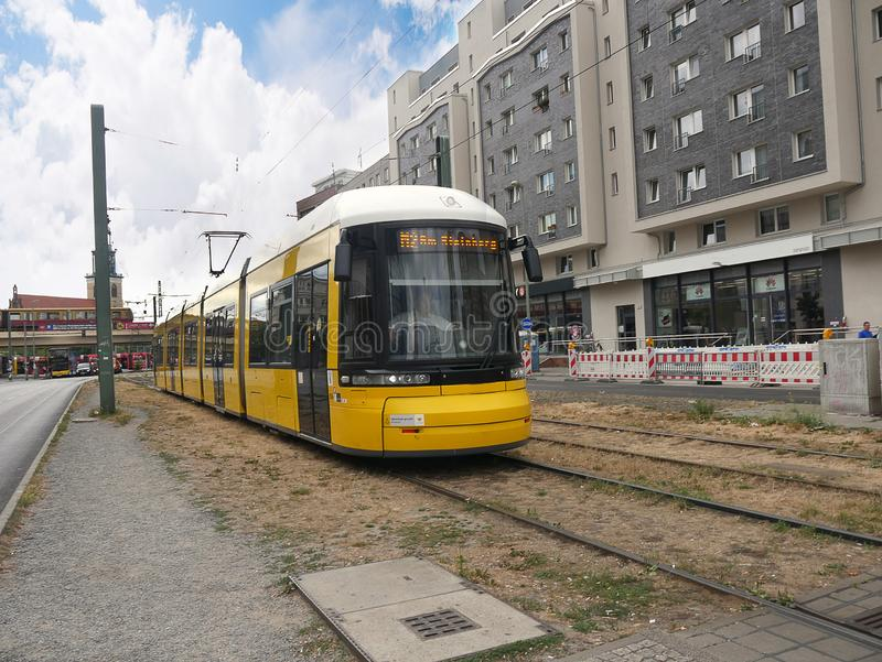 Tram in the Alexanderplatz in Berlin Germany. The Alexanderplatz district of Berlin is now a vibrant area with shops, restaurants. department stores and stock image
