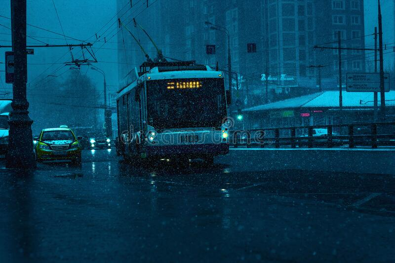Tram on city streets in rain royalty free stock photos