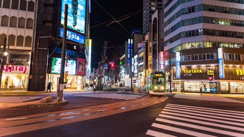 Tram di Sappopo alla notte intorno al dsitrict di Susukino immagini stock libere da diritti