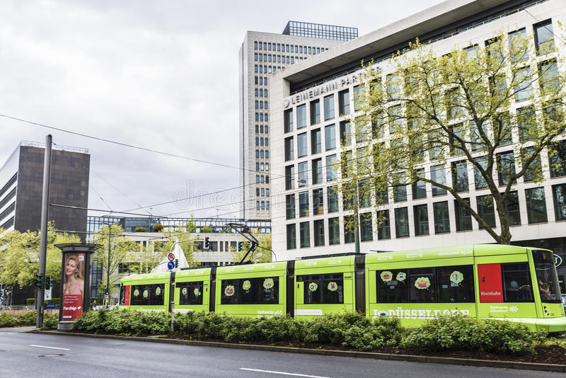 Tram in Dusseldorf, Germany. Dusseldorf, Germany - April 16, 2017: Tram with advertising in Dusseldorf, Germany on April 16, 2017 stock images