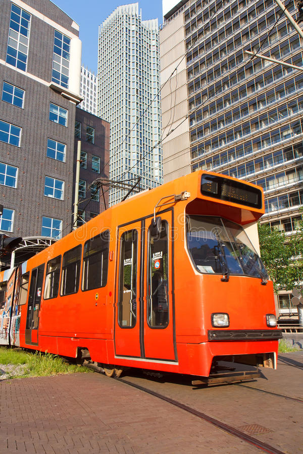 Tram getting out from a building stock image