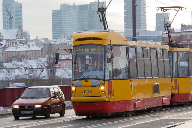 Tram we go on the bridge through Vistula in Warsaw stock image