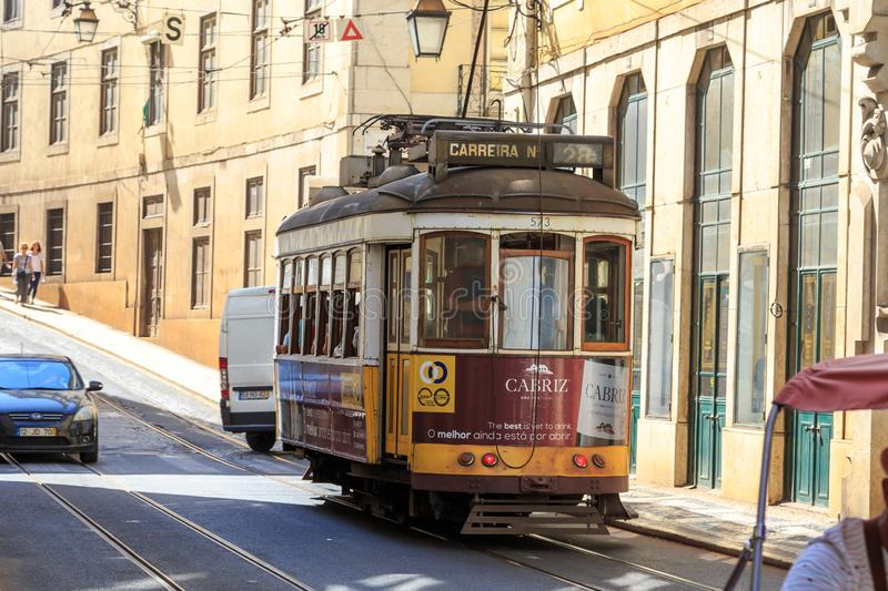 Lisbon tram 28. Tram on the legendary line 28 of the Lisbon tram system. This line runs with historic old tram cars and is a major tourist attraction of the city stock photo