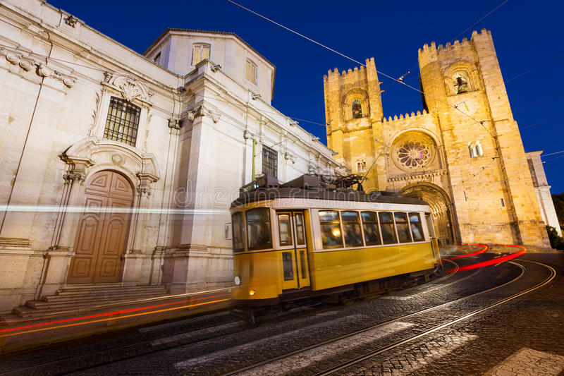 Tram in Lisbon at night. Tram in front of the Lisbon Cathedral at night stock image