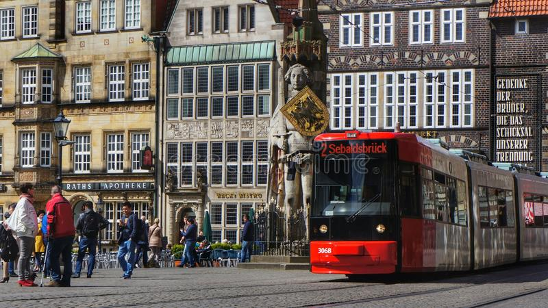 Tram on market square in Bremen, Germany. Editorial: Bremen, Germany, 17th April 2016. Tram trolley of the local company for public transportation passing the stock photography