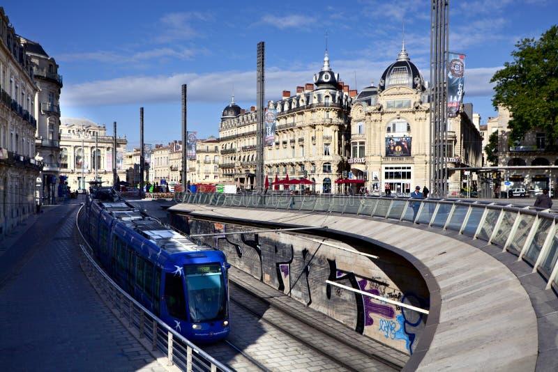 Tram op Place DE La Comedie in Montpellier stock afbeelding