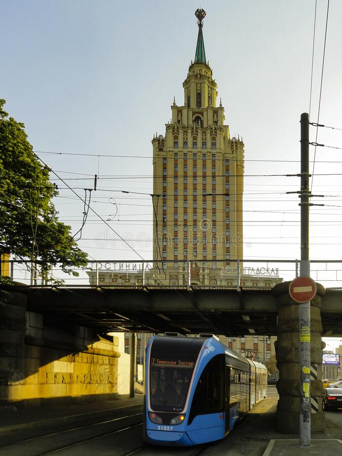 Tram passing under Kalanchevsky viaduct with view of Leningradskaya hotel. Tram passing under Kalanchevsky viaduct with view of Leningradskaya hotel in Moscow stock images